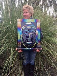 Whitmore, outside her studio on Camano Island, with her latest Buddha creation