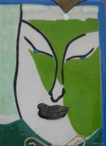 A glass Kwan Yin radiates compassion