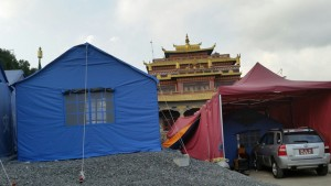 The tents, in front of a monastery, are emergency housing still in use 5 months after the earthquake. This is the Boudha neighborhood of Kathmandu, where many Tibetan Buddhist live