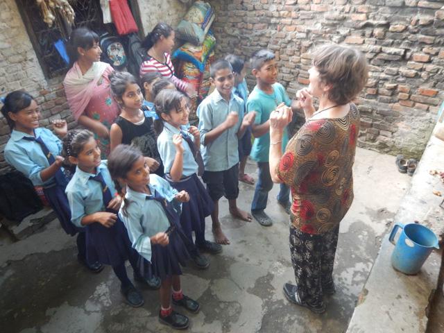 Susan Alotrico leading Nepali children in uplifting activity