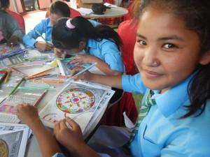 Student colors a mandala of strength at healing arts camp