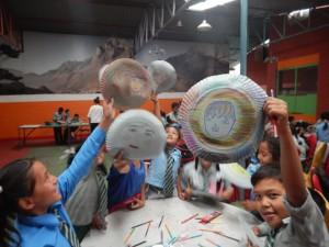Students hold emotion masks at Healing Arts Nepal camp