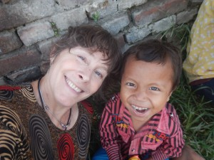 Susan Alotrico with Rawi, a young boy recovering from the earthquake