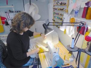 Lidunn Cain sewing a cushion cover