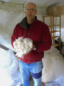 Christopher Cain shows what kapok looks like before it gets stuffed into a cushion