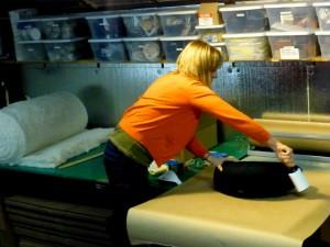 Lisa Daltstrand prepares a zafu for shipping by brushing it
