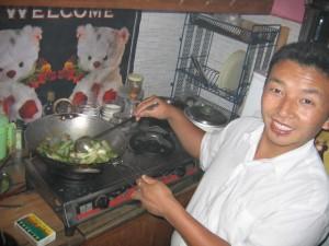 Mark's friend Singhi, demonstrating the finer aspects of Tibetan cooking in Mcleod Ganj, Dharamsala, India