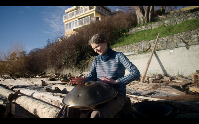 Storyteller Margo McLoughlin plays the Hang, a percussion instrument made in Switzerland, taken on a Victoria, B.C. beach