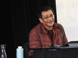 "Ponlop Rinpoche laughs as he teaches on his new book, ""Emotional Rescue,"" during a recent weekend event at Nalanda West in Seattle"