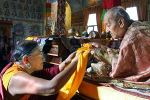 H.H. Sakya Trizin offering a kata, a ceremonial scarf, to H.H. Dagchen Rinpoche at a long-life ceremony