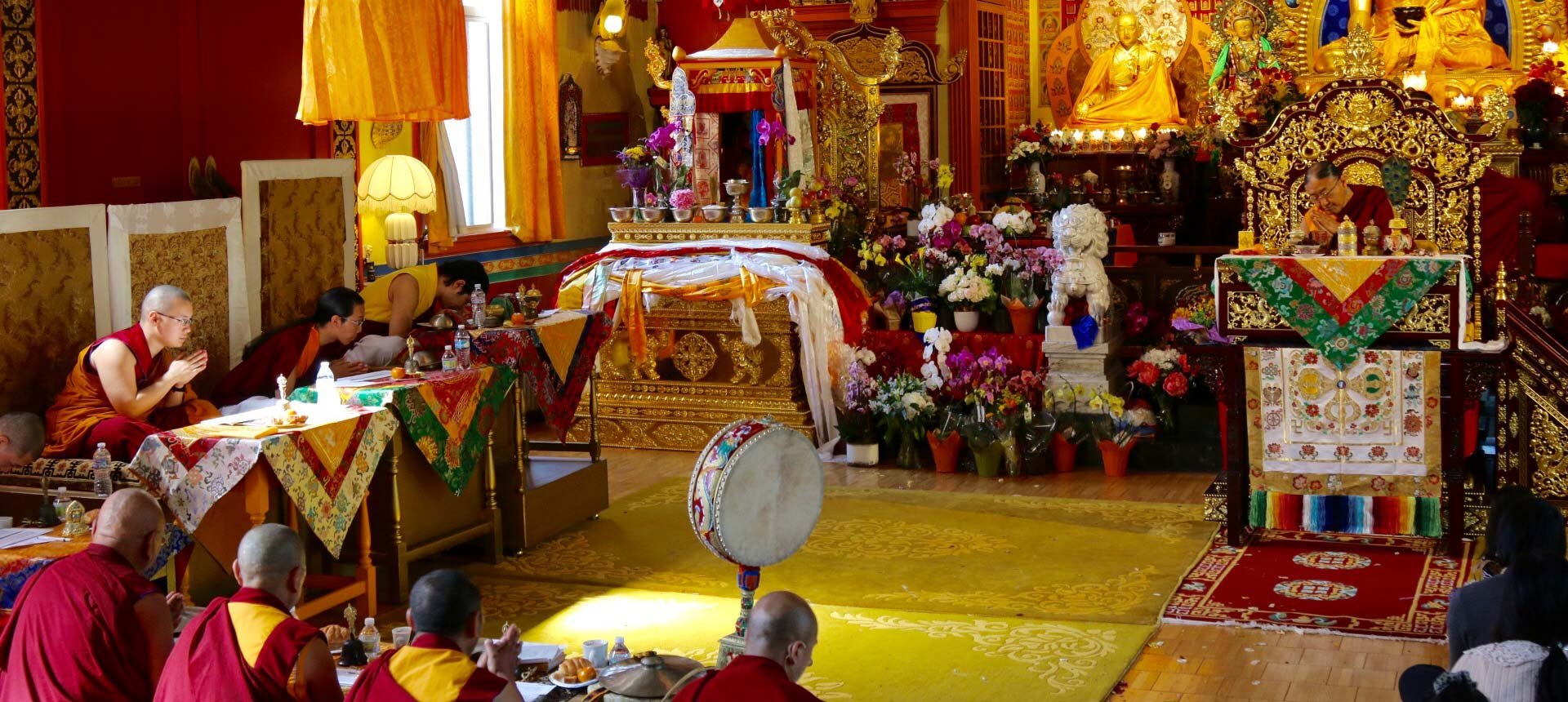 Tibetan Buddhist leaders and family bow toward the Ku-dung, the remainder of His Holiness Jigdal Dagchen Sakya's body, after his mind spent six days meditating on the clear light stage after his body's death