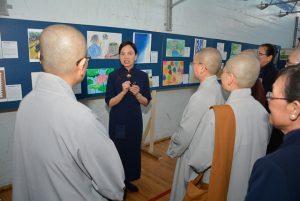 Monastics view children's art at the event