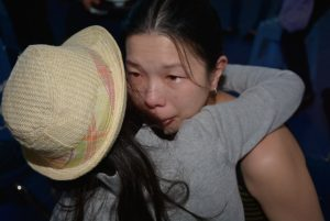 A mom in tears, after receiving a gift of tea from her child