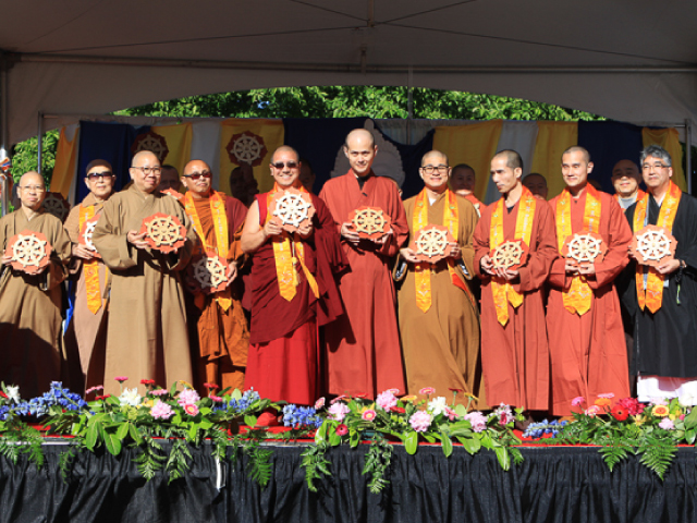 From left to right: Ven. Yin Tan Sik from Po Lam Buddhist Association (Mahayana Chinese); Ven Yin Guang; Ven. Yin Kit from Po Lam Buddhist Association (Mahayana Chinese); Abbot Ven. Santipalo from Khmer Buddhist Temple Association (Theravada Khmer/ Cambodia); Tsengdok Rinpoche from Tsengdok Monastery (Vajrayana Tibetan); Ven. Shi Yuan – Yi from Great Enlightenment Buddhist Institute Society (Vajrayana Taiwan); Abbot Ven. Tian Wen from Tung Lin Kok Yuen Canada Society (Mahayana Chinese); Ven. Shi Xing – Guang and Ven. Shi Xing- Yun from Great Enlightenment Buddhist Institute Society (Vajrayana Taiwan); Rev. Grant Ikuta, Steveston Buddhist Temple (Mahayana Japanese)