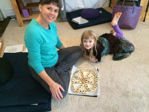 Caitlin Douglas and her daughter made a dharma wheel from dough, now ready for baking.