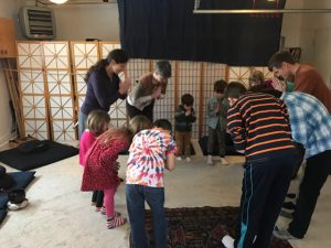 Children gather at the zendo for a generosity ceremony, in which each child offers a personal item on the altar, then bows.