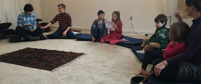 The Anchorage Zen Community nurtures the next generation's wisdom, kindness and generosity through a monthly dharma school. Sometimes the children act out stories from the Buddha's life, and sometimes, as in this photo, they sing together. Click on photo to go to story >>