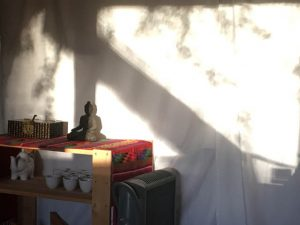 The shrine room, a shaft of sun.