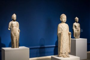 Three standing Buddhas, made of limestone and marble, from China and Thailand, are as old as the sixth century.