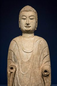 A standing Buddha from China, made of marble, from the late 6<sup>th</sup> century.
