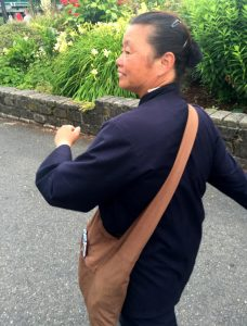 This woman, also dressed in monastic clothing, also was panhandling in June.