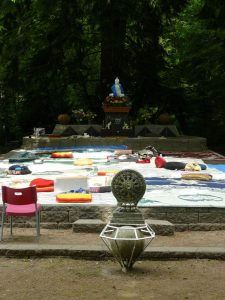 The outside practice area, under trees, set up for a dharma talk.