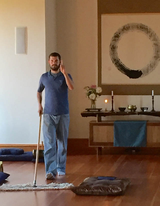 Jeff Rothman cleaning the zendo at Heart of Wisdom.