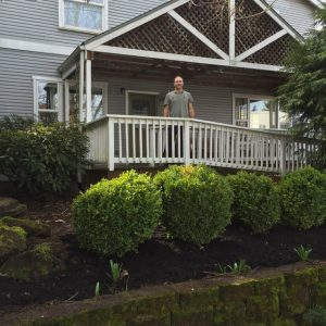 Taking a rest at Trillium House after planting new shrubs.