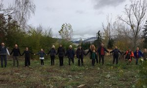 Ashland Zen Center sangha members stand together where they will break ground on their new building project.