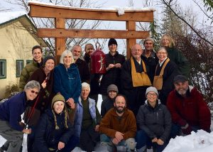 At the end of Rohatsu sesshin in 2015, warm smiles in the snow. The sangha surrounds Senseis Jintei Harold Little and Etsudo Patty Krahl.