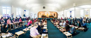 The Nalanda West shrine room filled with participants during a teaching session by Dzogchen Ponlop Rinpoche.