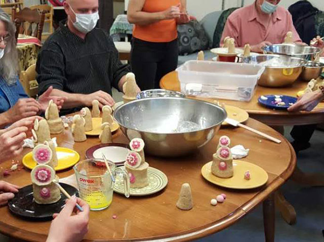 Sangha members making tormas, traditional Tibetan offerings of flour and butter, before a Vajrasattva retreat.