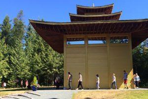 Sangha members circumambulate the Padmasambhava statue.