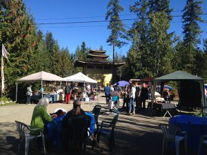 Visitors join with sangha members during the annual Happy Festival.