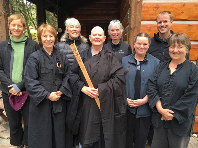 The Sakuraji sangha traveled to Montana to support Kuya Minogue, center, in her ordination. Interim leader Lorraine Smith, also known as Habukai, is immediately to her right in a traditional black robe.