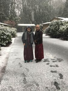 Rinpoche and translator Tashi enjoy the snow in front of Mandell's Portland home.