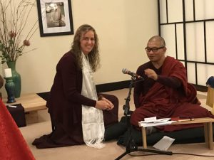 Margaret Janssen  making an offering to Tashi, Adzom Gyalse Rinpoche's translator.