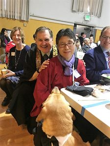 Rinban Castro, his wife Shuri Saigusa and their dog Sparky at Castro's November retirement party.