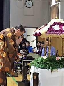 Rinban bowing to Baby Buddha during 2001 Buddha's birthday (Hanamatsuri) service at Seattle Betsuin.