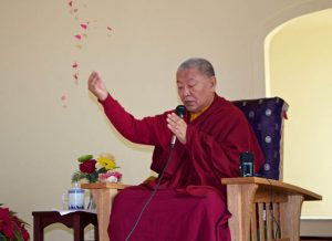 Ringu Tulku offering blessing for the new center. His visit fortuitously coincided with finalizing the purchase.