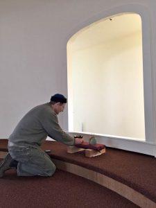 Jef Gunn offering incense before starting renovation work.