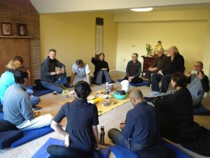 Ocean Light Zen Sangha sharing a meal after ceremony, in an earlier facility, in late 2011.