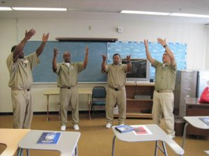 Nate, second from right, leads a mindful movement exercise, a component of every class.