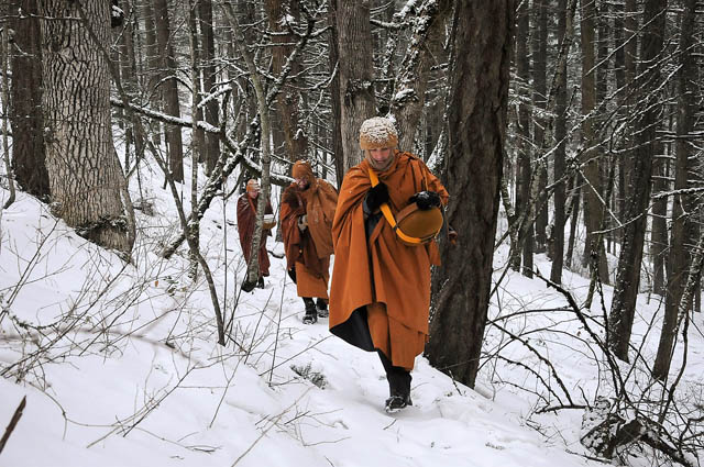 The monks walk alms rounds every morning to receive food for their daily meal and to connect with the community, sometimes through heavy snow. Ajahn Sudanto, Tan Saddhammo and Tan Kondañño.