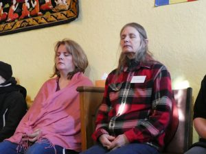 Lora Dow and Suzan Wilson, deep in meditation.