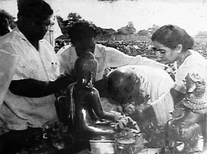 Dr. Ambedkar taking Buddhist deeksha (ordination), before leading the same ceremony for 300,000 Bahujan on Oct.15, 1956, in Nagpur, India. His wife Dr. Savita Ambedkar is at his side.