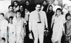 Dr.Ambedkar in a group photograph with female Buddhist activists.