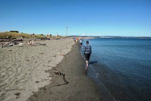 A Sangha member walks after the picnic. Port Townsend is known for its artists, its beaches, and the surrounding waters of the Salish Sea.
