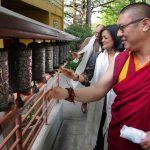 Abbot of Sakya Monastery Khenpo Jampa Tenphel, Congresswoman Jayapal and her husband, spinning prayer wheels outside the monastery.