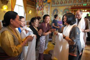 Members of Seattle Tibetan community welcoming Congresswoman Pramila Jayapal and her husband Steve Williamson, in the main shrine hall of the monastery.